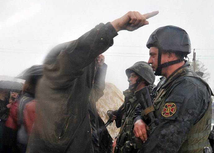 Ukrainian soldiers listen to anti-government protestors blocking the Kramatorsk to Slavyansk road to prevent the Ukrainian National Guard troops from advancing on May 2, 2014.