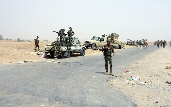 Kurdish Iraqi Peshmerga forces deploy their troops and armoured vehicles on the outskirts of the multi-ethnic city of Kirkuk, only 1 kilometre away from areas controlled by Sunni Muslim Jihadists from the Islamic State of Iraq and the Levant (ISIL) in northern Iraq on June 12, 2014. (AFP Photo / Marwan Ibrahim)