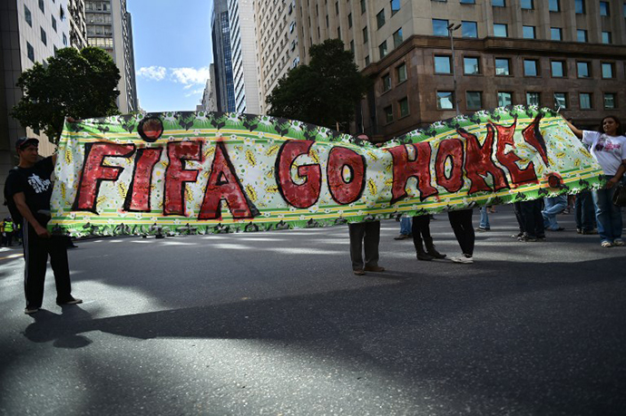Demonstrators take part in an anti-World Cup protest in Rio de Janeiro on June 12, 2014. (AFP Photo / Yasuyoshi Chiba)