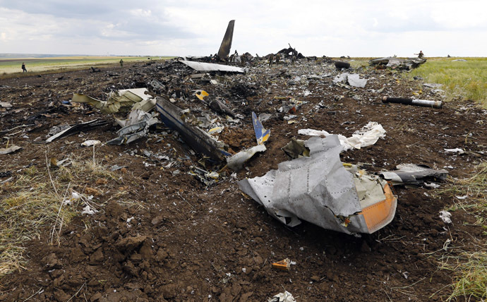 Self-defense forces gather ammunition at the site of the crash of the Il-76 Ukrainian army transport plane in Luhansk, June 14, 2014. (Reuters/Shamil Zhumatov)