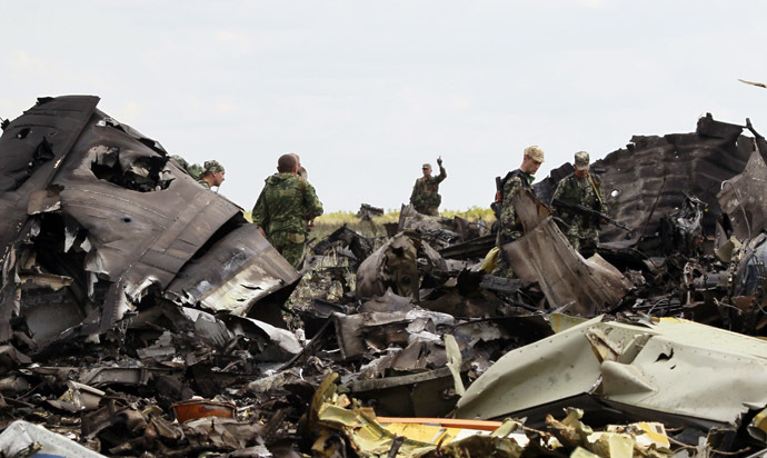 Self-defense forces search for ammunition at the site of the crash of the Il-76 Ukrainian army transport plane in Luhansk, June 14, 2014. (Reuters/Shamil Zhumatov)