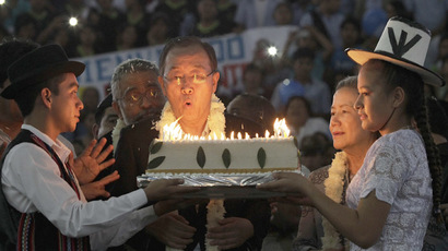 United Nations Secretary-General Ban Ki-moon blows the candles on a cake during a celebration for his 70th birthday at an event organized by Bolivia's President Evo Morales in El Torno, near Santa Cruz de la Sierra, June 13, 2014. (Reuters/David Mercado)
