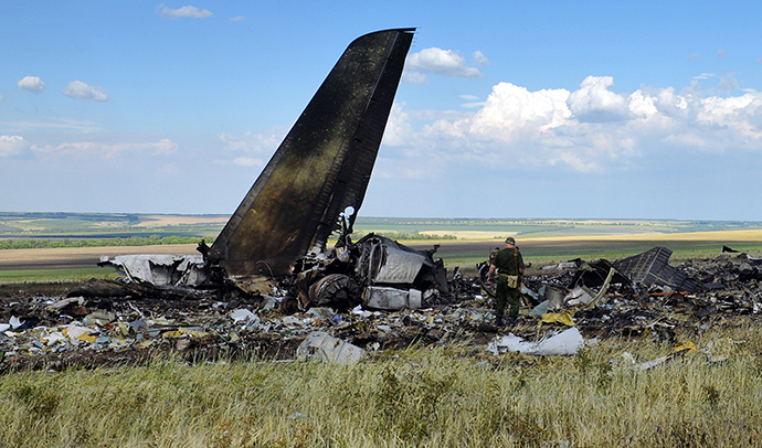 The debris of an IL-76 transporter which was taken down by pro-Russian rebels early on June 14, on the outskirts of Lugansk June 14, 2014. (AFP Photo / Daniel Mihailescu)