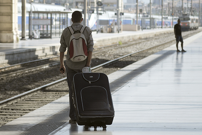 Travelers walk on a platform at the Saint-Charles station on June 13, 2014 in Marseille, on the third day of a national strike by French SNCF railway company employees. (AFP Photo / Boris Horvat)