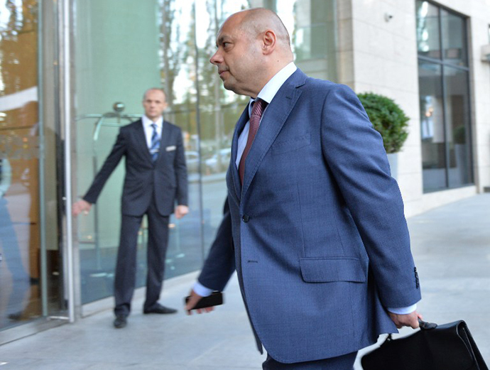 Ukrainian Minister of Energy and Coal Industry Yury Prodan arrives to take part in the next round of gas supply talks with Russian Gazprom company in Kiev on June 14, 2014. (AFP Photo / Genya Savilov)