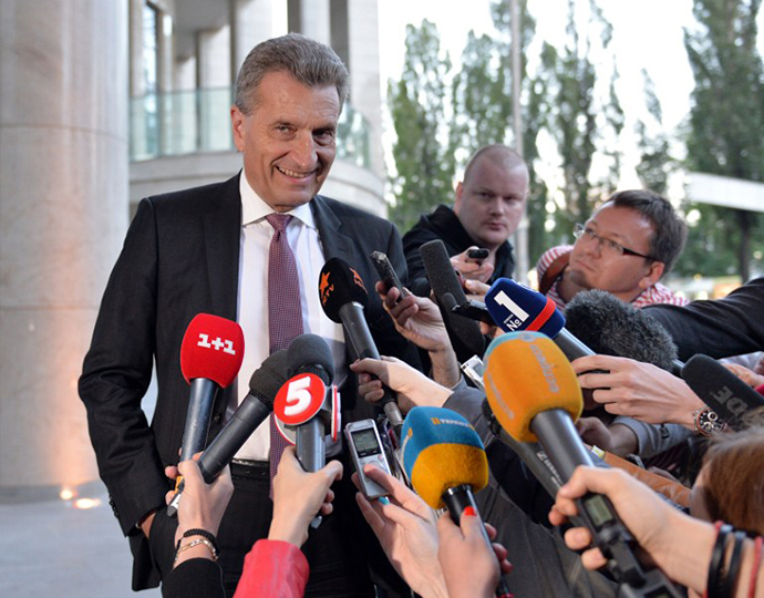 EU Energy Commissioner Guenther Oettinger speaks to the media prior to a round of talks with Russian Gazprom company and Ukraine's energy minister, in Kiev on June 14, 2014. (AFP Photo / Genya Savilov)
