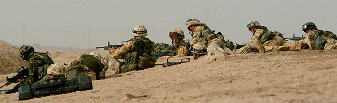 A reconnaissance party from 29 Commando Regiment Royal Artillery land on the al-Faw Peninsular in southern Iraq to establish the gun position ahead of 105mm guns arriving, March 21, 2003. (Reuters / Stephen Hird)