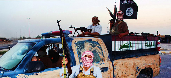 Militants of the Islamic State in Iraq and the Levant (ISIS) riding in a captured vehicle left behind by Iraqi security forces at an unknown location in the Salaheddin province on June 14, 2014. (AFP Photo / HO / Welayat Salahuddin)