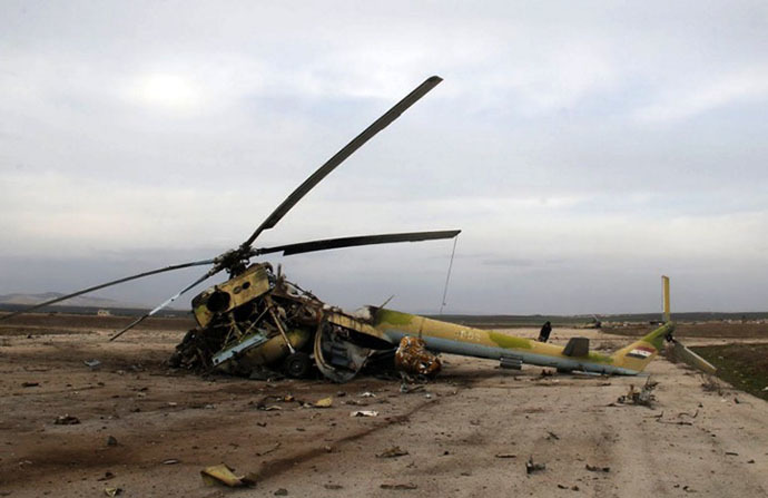 A picture taken on March 1, 2014 shows the wreckage of a Syrian army helicopter after al-Qaeda-linked group Islamic State of Iraq and the Levant (ISIL)'s fighters allegedly destroyed it. (AFP Photo / Mohammed Al-Khatieb)