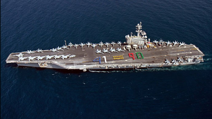A handout picture released by the US Navy shows aircraft carrier USS George H.W. Bush (CVN 77) sailing in the Arabian Sea on June 13, 2014. (AFP Photo)