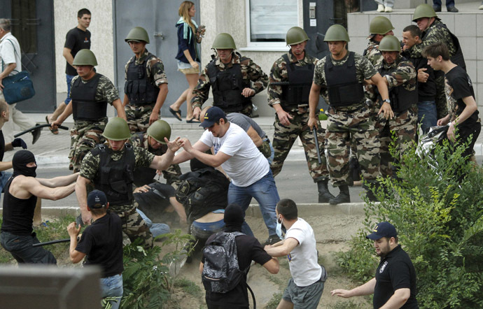 Security guards scuffle with protesters during a rally near the Russian consulate-general in Odessa June 16, 2014. (Reuters)
