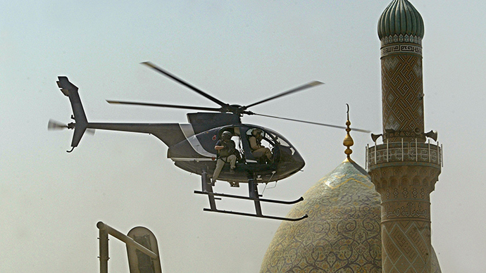 ARCHIVE PHOTO: A helicopter of Blackwater security firm flies low above the scene where a roadside bomb exploded near the Iranian embassy in central Baghdad, 05 July 2005 (AFP Photo / Yuri Cortez)