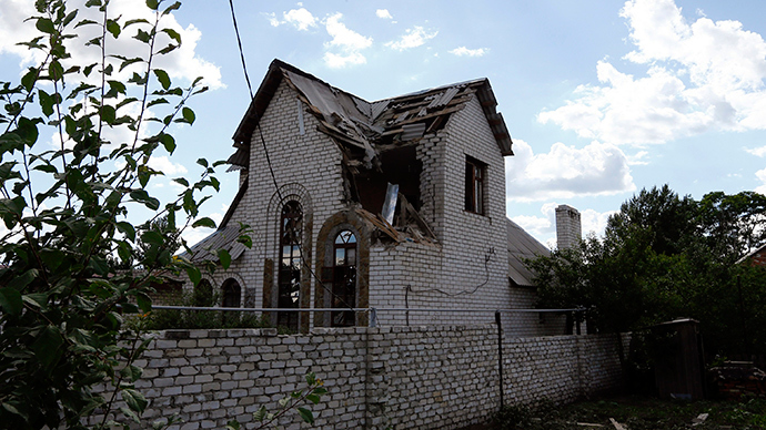 A house damaged by fighting between Ukrainian and anti-government forces is seen in the eastern Ukranian city of Slaviansk June 16, 2014 (RIA Novosti / Shamil Zhumatov)