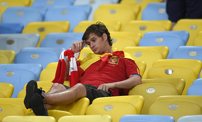 A Spain fan reacts after the Group B football match between Spain and Chile in the Maracana Stadium in Rio de Janeiro during the 2014 FIFA World Cup on June 18, 2014. (AFP Photo / Lluis Gene)