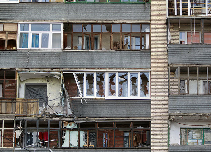 A building damaged by shelling from government forces is seen in the eastern Ukranian city of Slaviansk June 16, 2014. (Reuters / Shamil Zhumatov)