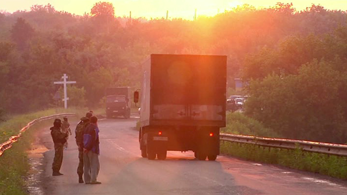 Truck containing bodies passing by on road to Ukrainian side. Still from AP video