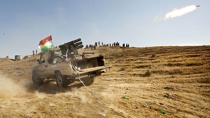 Kurdish Peshmerga forces fire missiles during clashes with militants of the Islamic State of Iraq and the Levant (ISIL) jihadist group in Jalawla in the Diyala province, on June 14, 2014. (AFP Photo / Rick Findler)