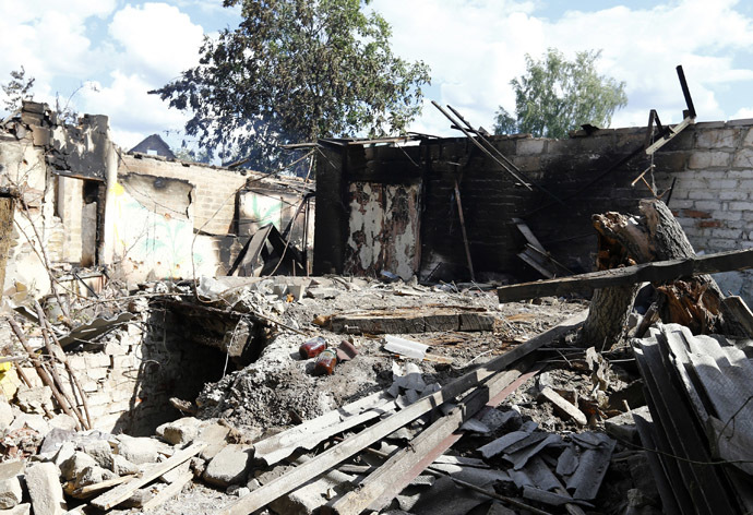 A house damaged by fighting between Ukrainian and and anti-government forces is seen in the eastern Ukranian city of Slaviansk June 16, 2014. (Reuters/Shamil Zhumatov)