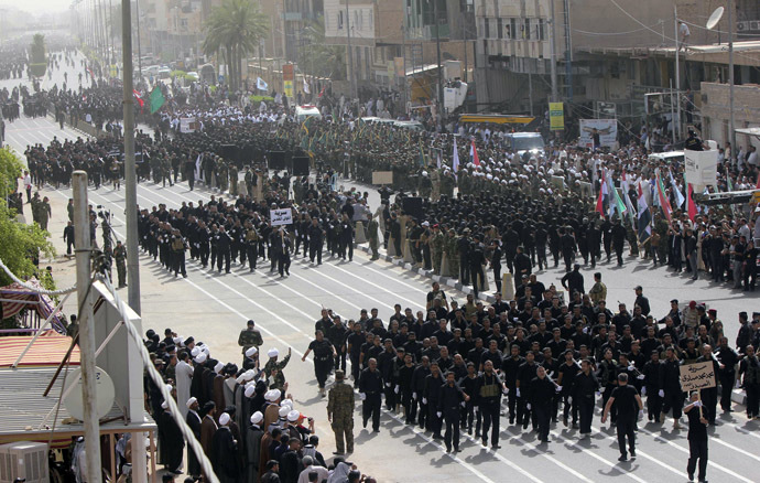 Mehdi Army fighters loyal to Shi'ite cleric Moqtada al-Sadr march during a parade in Najaf, June 21, 2014. (Reuters/Alaa Al-Marjani)