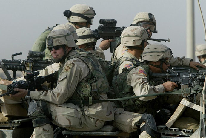 US troops from the 82nd Airborne division take position during a search for a weapons cache in Fallujah, 50 kms (30 miles) west of Baghdad, 07 November 2003. (AFP photo / Patrick Baz)