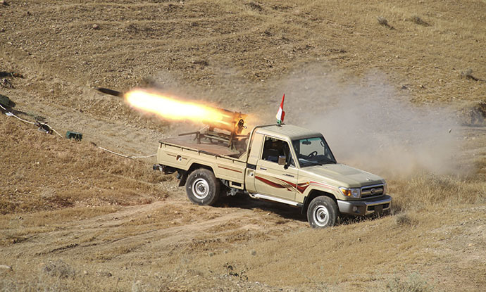 A vehicle belonging to Kurdish security forces fires a multiple rocket launcher during clashes with Sunni militant group Islamic State of Iraq and the Levant (ISIL) on the outskirts of Diyala June 14, 2014. (Reuters / Yahya Ahmad)