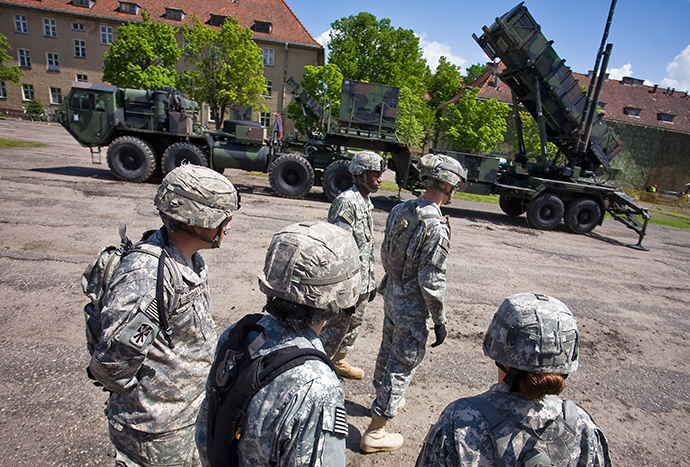 US soldiers stand in front of a Patriot missile battery at an army base in the northern Polish town of Morag (AFP Photo)