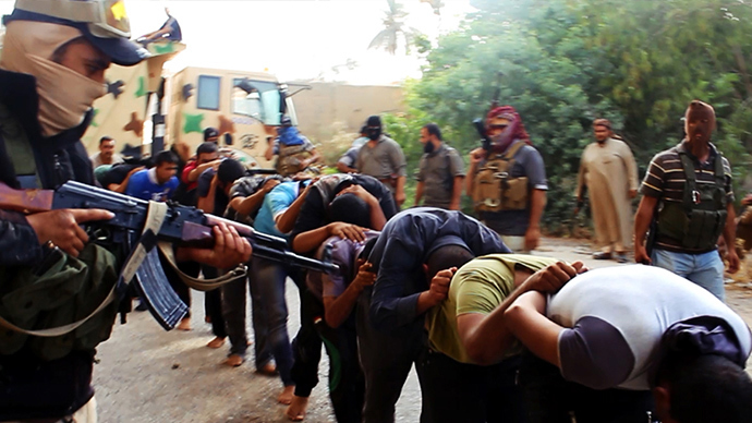 An image uploaded on June 14, 2014 on the jihadist website Welayat Salahuddin allegedly shows militants of the Islamic State of Iraq and the Levant (ISIL) capturing dozens of Iraqi security forces members prior to transporting them to an unknown location in the Salaheddin province ahead of executing them (AFP Photo)