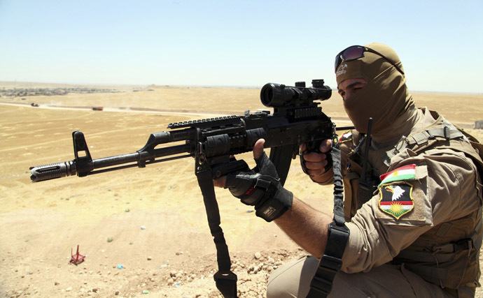 A member of Kurdish security forces aims his rifle during an intensive security deployment and a patrol looking for militants of the Islamic State of Iraq and the Levant (ISIL), on the outskirts of Mosul, June 22, 2014. (Reuters/Azad Lashkari)
