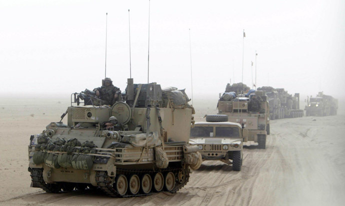 U.S. Army soldiers in heavy armour vehicles cross the border into Iraq from Kuwait early March 21, 2003. (Reuters/Kai Pfaffenbach)
