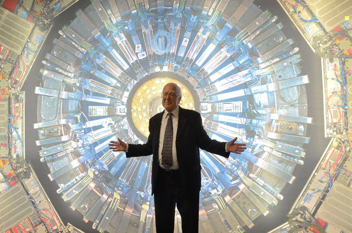 British scientist Peter Higgs poses in front of a photographic image of the Atlas detector at the Science Museum in London (Reuters / Toby Melville)