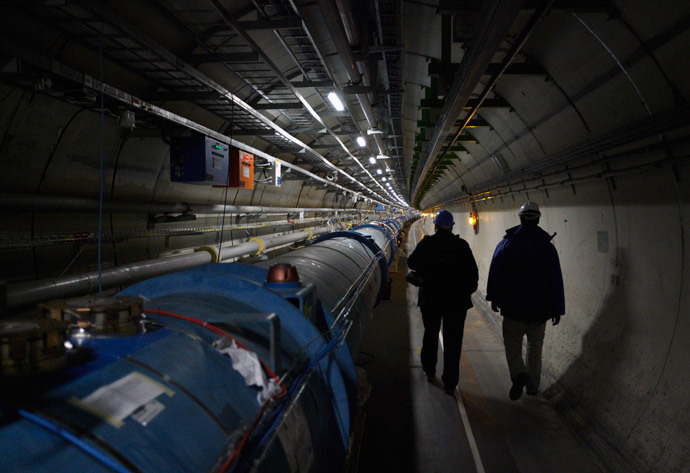CERN staff walk in the LHC (Large Hadron Collider) tunnel during a visit at the Organization for Nuclear Research (CERN) in Meyrin, near Geneva (Reuters / Denis Balibouse)