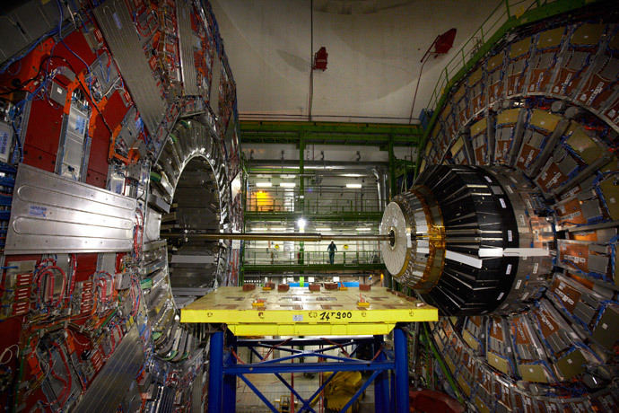 A technician stands near equipment of the Compact Muon Solenoid (CMS) experience at the Organization for Nuclear Research (CERN) in the French village of Cessy near Geneva in Switzerland (Reuters / Denis Balibouse)
