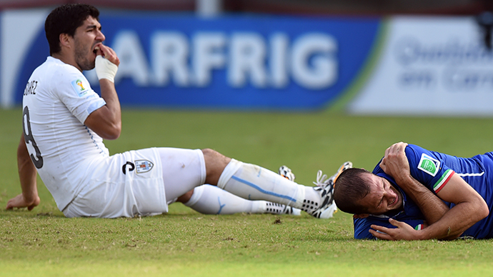 Uruguayan striker Luis Suarez takes a bite out of the competition, social media erupts