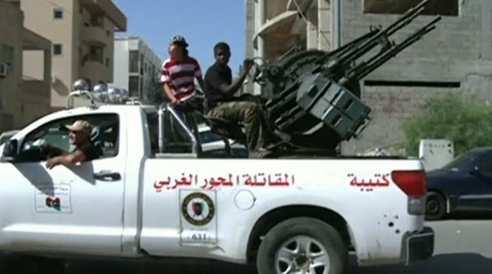 Armed militants and gangsters in the streets of Libya (RT video screenshot)
