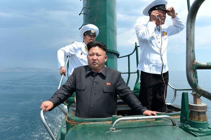 North Korean leader Kim Jong-Un (C), (AFP Photo / KCNA via KNS Republic of Korea out)