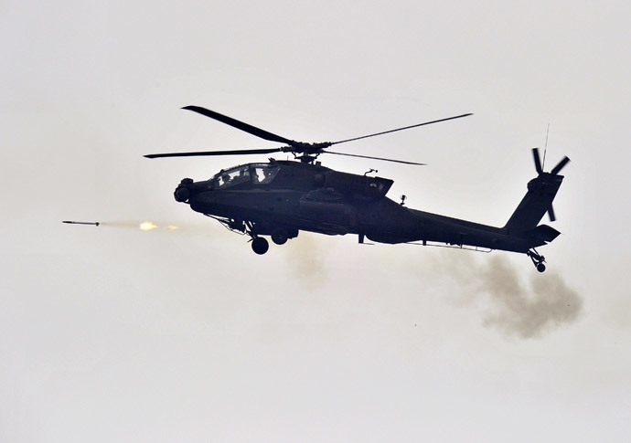 A US AH-64 Apache helicopter fires rockets (AFP Photo / Jung Yeon-Je)