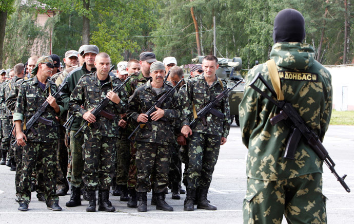 "Members of the ""Donbass"" self-defence battalion attend a ceremony to swear the oath to be officially included into the reserve battalion of the National Guard of Ukraine near Kiev June 23, 2014. (Reuters / Valentyn Ogirenko)"