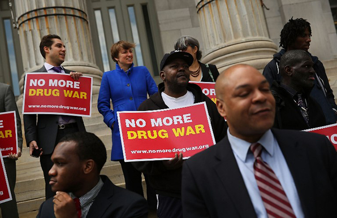 Elected officials, community leaders and local activists attend a rally outside Brooklyn borough hall in support of the district attorney's plans to end prosecuting minor marijuana offenses on April 25, 2014 in New York City. (AFP Photo / Getty Images / Spencer Platt)