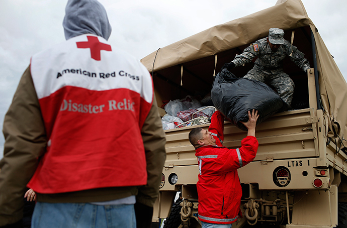 ARCHIVE PHOTO: U.S. National Guard and American Red Cross volunteers unload donated supplies for hurricane Sandy victims at a FEMA and American Red Cross aid and disaster relief station in the hard-hit Staten Island section of New York City, November 2, 2012 (Reuters / Mike Segar)