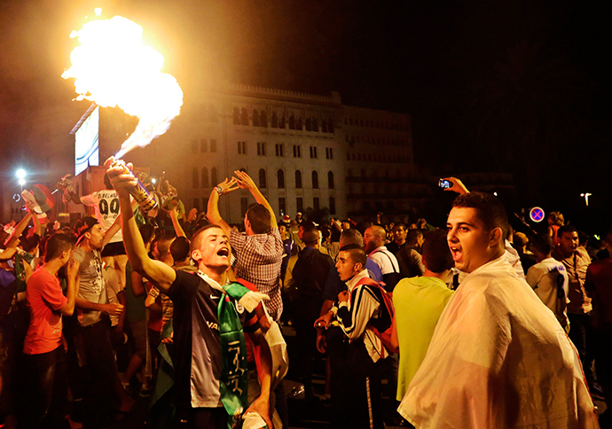 People celebrate on the street after the end of Algeria's 2014 World Cup Group H soccer match against Russia, in Algiers June 26, 2014 (Reuters / Louafi Larbi)