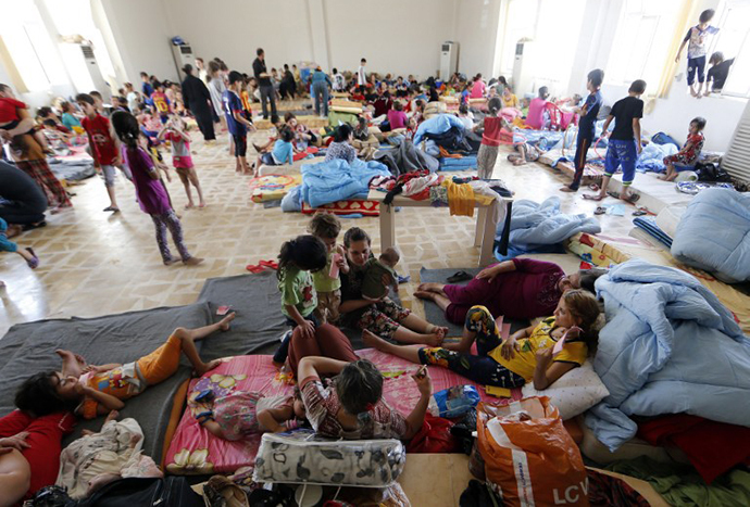 Iraqi Christian families fleeing the violence in the village of Qaraqush and Bartala, about 30 kms east of the northern province of Nineveh, are pictured at a community center in the Kurdish city of Arbil in Iraq's autonomous Kurdistan region, on June 27, 2014. (AFP Photo / Karim Sahib)