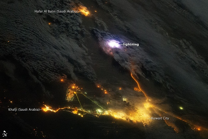 A white flash of lightning above Kuwait and Saudi Arabia, as seen from the International Space Station on December 12, 2013 (Image from earthobservatory.nasa.gov)