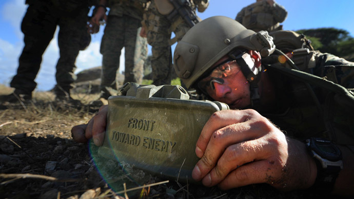A US Marine emplaces a Claymore mine (Image from Wikipedia.org)