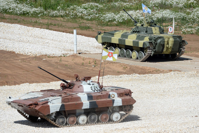 Crews of BMD-4M airborne fighting vehicles take part in the Tank Biathlon-2014 competitions at the Alabino training center of the Second Taman Guards Motorized Rifle Division. (RIA Novosti/Kirill Kallinikov)