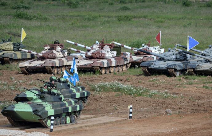 BMD-4M armored infantry fighting vehicles and T-72B tanks during Tank Biathlon 2014 competition held at the shooting range of the 2nd Guards Motor Rifle Tamanskaya Division in Alabino village. (RIA Novosti/Kirill Kallinikov)
