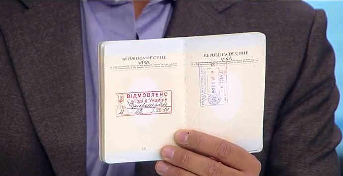 Mauricio Ampuero's passport (Screenshot from RT Spanish video)