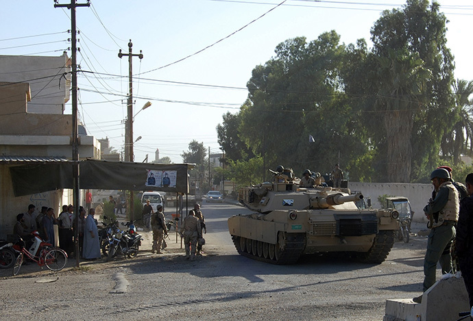 A tank from the Iraqi security forces patrols during an intensive security deployment on the outskirts of the city of Samarra, June 25, 2014. Iraqi troops were trying to advance on Tikrit from the direction of Samarra to the south that has become the military's line in the sand against a militant advance by the radical Sunni Islamic State in Iraq and the Levant (ISIL) group southwards towards Baghdad. (Reuters)