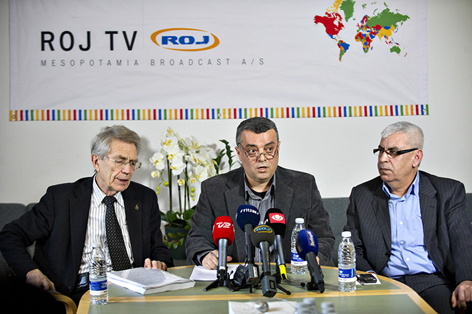 CEO of the Kurdish ROJ TV Imdat Yimmaz(C), flanked by defence attorney Bjorn Elmquist(L) and chairman of the board Jamil Bozo(R) (AFP Photo / Jens Noergaard Larsen)