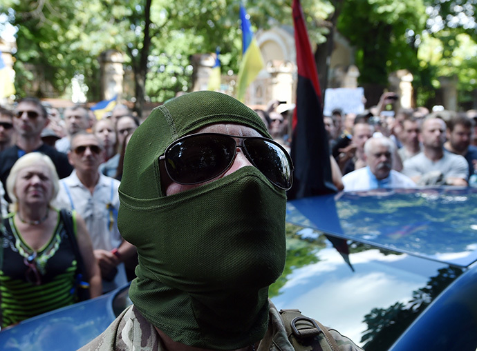 "A masked man, soldier of the volunteer Ukrainian army ""Donbass"" battalion, takes part in a rally by Maidan activists at Independence Square in Kiev on June 29, 2014. (AFP Photo / Sergei Supinsky)"