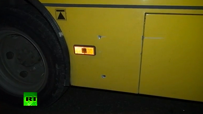 Alleged bullet holes in the bus (screenshot from RT video)